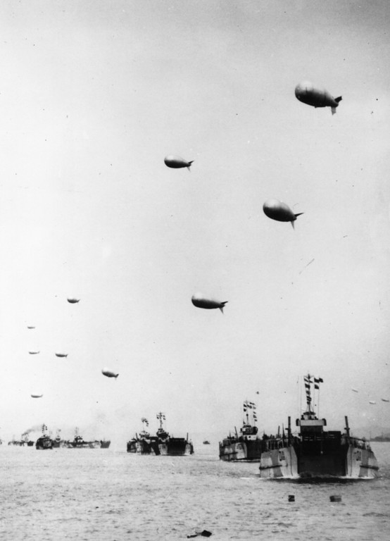 . A long line of LST or Landing Ship-Tanks, each towing a protective barrage balloon, are seen heading away from the English coast carrying supplies to the French beachhead June 6, 1944.  (Photo by Keystone/Getty Images)