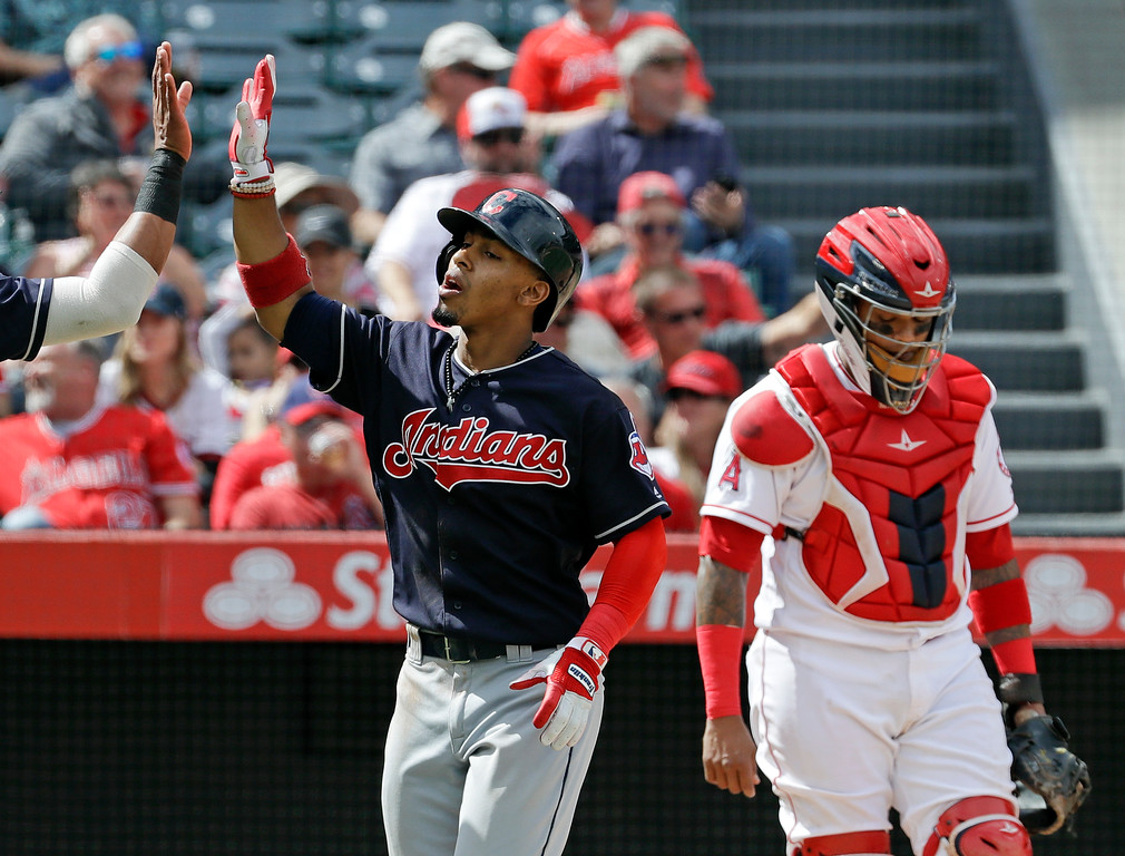 . Cleveland Indians\' Francisco Lindor celebrates past Los Angeles Angels catcher Martin Maldonado after his three-run home run during the fifth inning of a baseball game in Anaheim, Calif., Thursday, Sept. 21, 2017. (AP Photo/Chris Carlson)