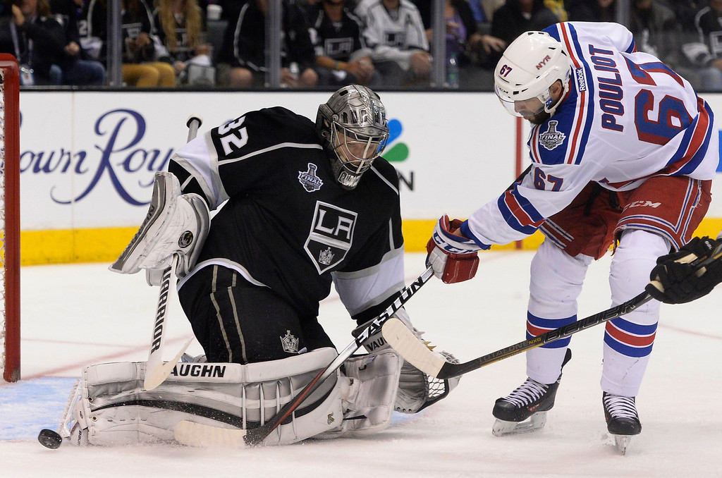 . Kings#32 Jonathan Quick blocks a shot by Rangers#67 Benoit Pouliot in the 2nd period. The Los Angeles Kings faced the New York Rangers in game 2 of the Stanley Cup Final.  Los Angeles, CA. 6/7/2014(Photo by John McCoy Daily News)