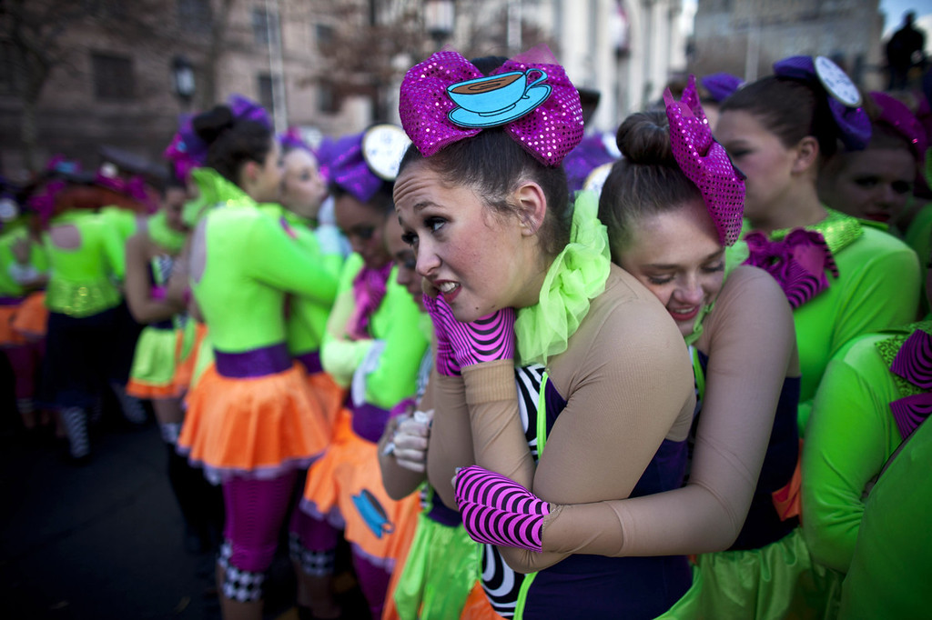 . A group of girls react to the cold weather as they attend the Macy\'s Thanksgiving Day Parade on November 28, 2013 in New York City. Despite earlier concerns about the wind, the balloons flew as planned for the parade. (Photo by Kena Betancur/Getty Images)