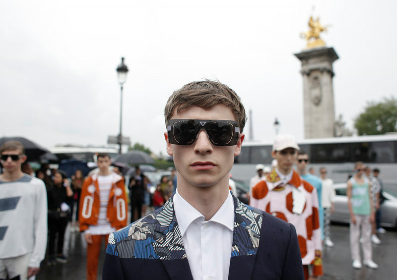 . Models pose on the Alexandre III bridge as part of Kenzo men\'s spring-summer 2015 fashion collection presented in Paris, France, Saturday, June 28, 2014. (AP Photo/Thibault Camus)