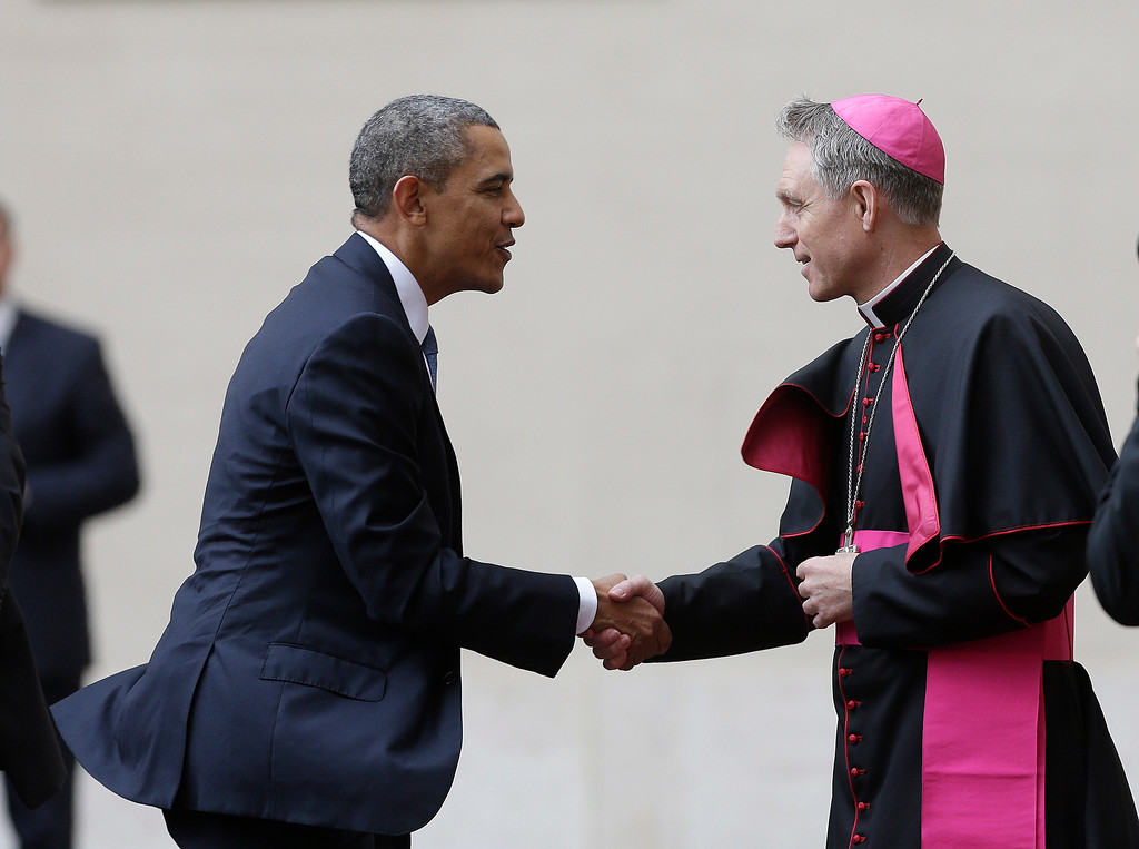 . President Barack Obama, left, is welcomed by Archbishop George Gaenswein, prefect of the papal household, as he arrives at the Vatican to meet Pope Francis, Thursday, March 27, 2014. Obama is the ninth president to make an official visit to the Vatican. His audience marks a change of pace for the president, who has devoted the past three days of a weeklong, four-country trip to securing European unity against Russia\'s aggressive posture toward Ukraine. (AP Photo/Alessandra Tarantino)
