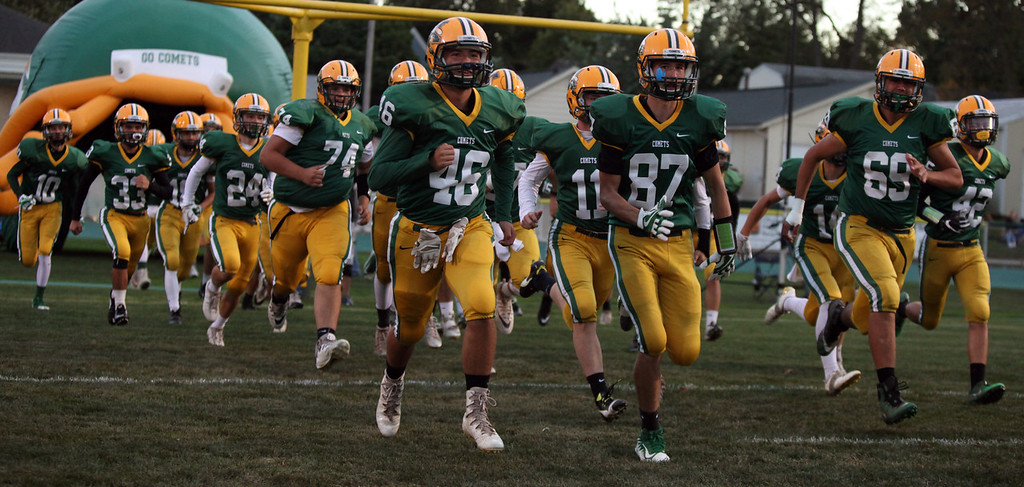 . The Amherst Comets football team takes the field against the Olmsted Falls Bulldogs on Sept. 29. 2017. The Comets play on grass. (Randy Meyers - The Morning Journal)