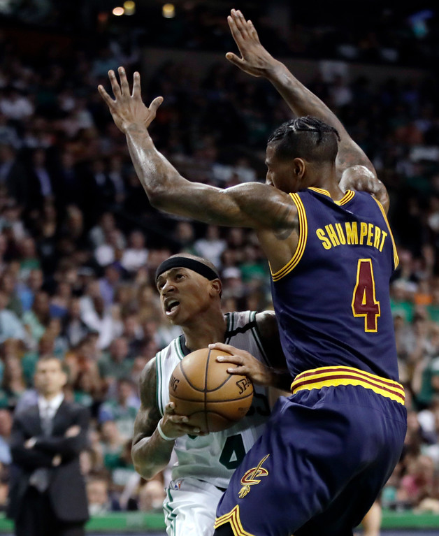 . Boston Celtics guard Isaiah Thomas, left, drives into the defense of Cleveland Cavaliers guard Iman Shumpert (4) during the first half of Game 2 of the NBA basketball Eastern Conference finals, Friday, May 19, 2017, in Boston. (AP Photo/Elise Amendola)