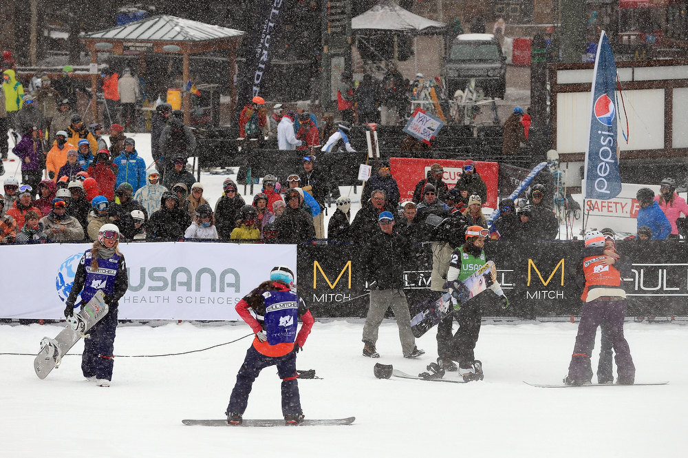 . Faye Gulini and Jacqueline Hernandez (R) of the USA celebrate as they finished fifth in the USANA Snowboardcross World Cup Team Event on December 15, 2012 in Telluride, Colorado.  (Photo by Doug Pensinger/Getty Images)