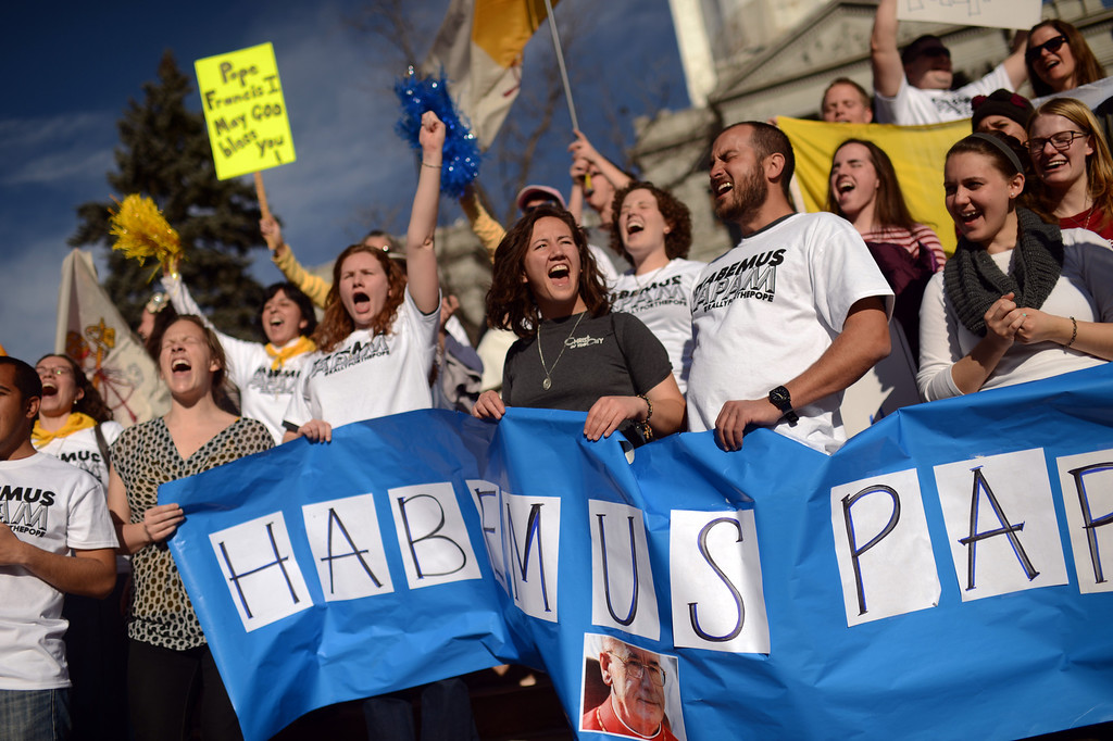 . DENVER, CO. - MARCH 13: Hillary DeRose from Arizona with gray t-shirts, front center, and Joseph Moreno from California, next to DeRose and people celebrate election of the new pope with a march from Civic Center to the Cathedral Basilica of the Immaculate Conception. Jorge Bergoglio of Argentina was elected new pope. March 13, 2013. Denver, Colorado. (Photo By Hyoung Chang/The Denver Post)