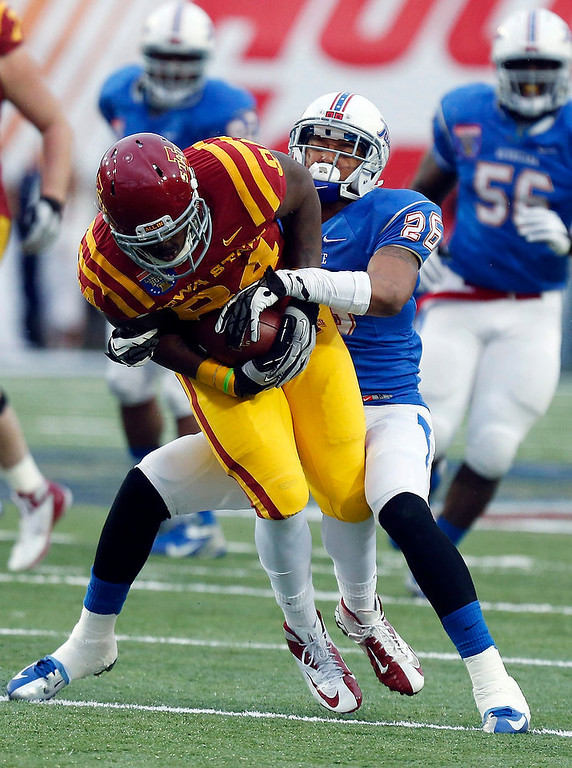 . Iowa State tight end Ernst Brun Jr. (84) is tackled by Tulsa defensive back Dexter McCoil (26) following a short pass reception during the first quarter of the Liberty Bowl NCAA college football game in Memphis, Tenn., Monday, Dec. 31, 2012. (AP Photo/Rogelio V. Solis)
