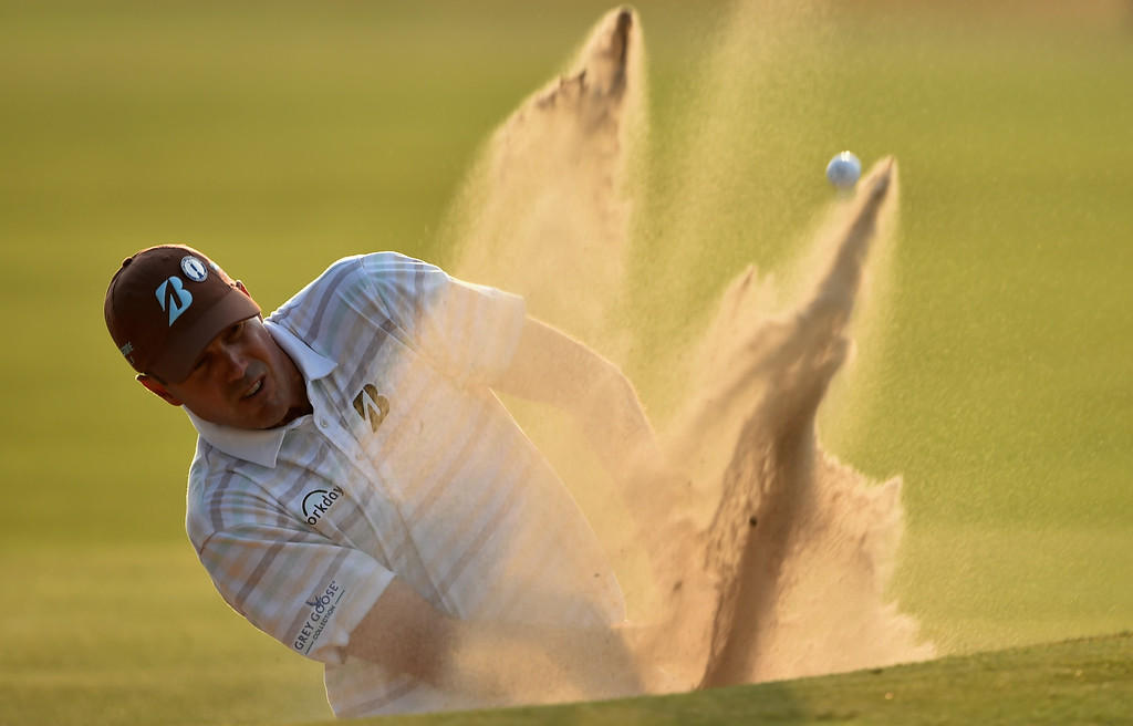 . HOYLAKE, ENGLAND - JULY 18:  Matt Kuchar of the United States hits from a bunker on the 18th hole during the second round of The 143rd Open Championship at Royal Liverpool on July 18, 2014 in Hoylake, England.  (Photo by Stuart Franklin/Getty Images)