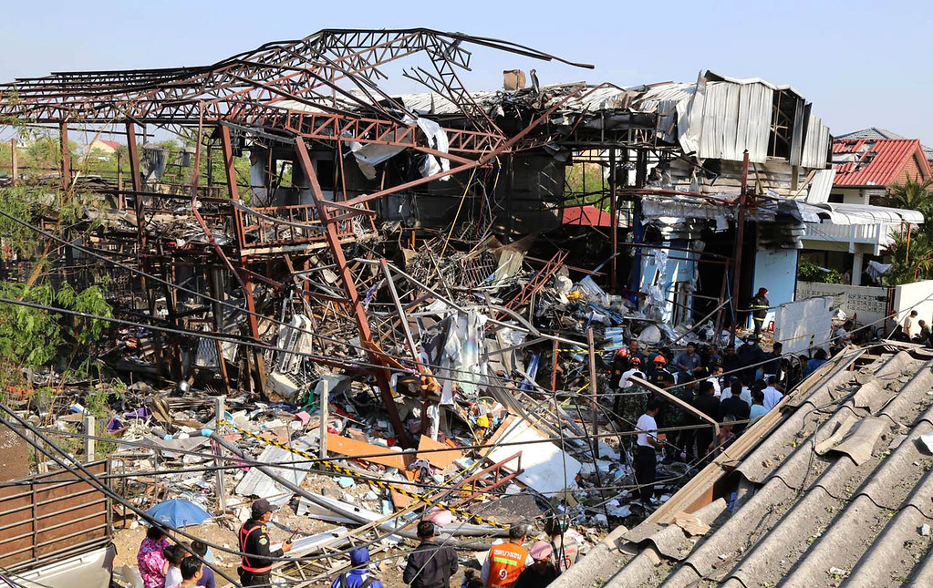 . Scrap shop building is damaged after an explosion Wednesday, April 2, 2014 in Bangkok, Thailand.  (AP Photo)