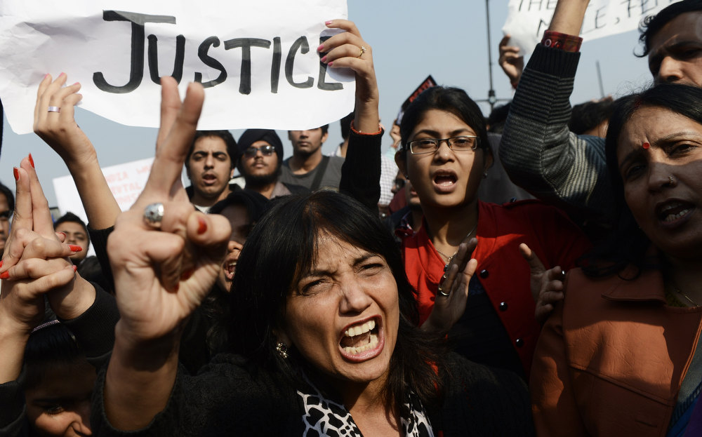 Description of . Indian demonstrators shout slogans during a protest calling for  better safety for women following the rape of a student last week, in front of the Government Secretariat and Presidential Palace in New Delhi on December 22, 2012. Indian police on December 22 baton-charged, tear-gassed and fired water cannon at demonstrators who were demanding better safety for women following the brutal gang-rape of a student last weekend. Thousands of protesters, who rallied at the India Gate monument in the heart of the Indian capital and surged toward the president's palace, were calling for stepped-up security for women across the country. SAJJAD HUSSAIN/AFP/Getty Images