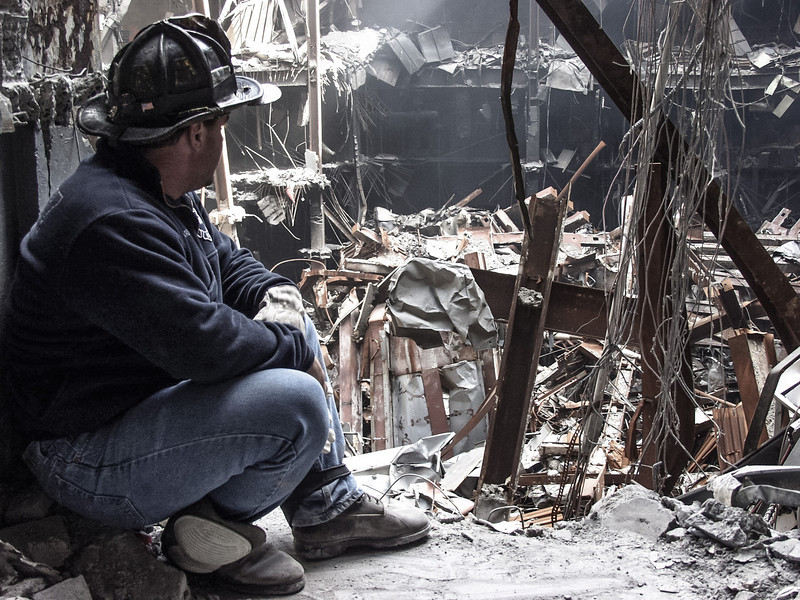 DR-1391-NY 9-26-2001 Tony Marden, FDNY of Ladder 165, found the crosses on day two  in building 6 of the world Trade Center at a place later named God House.   God House become a placce where Tony could go and remember his cousin Thomas Casoria of engin 22 who died in the collapse.