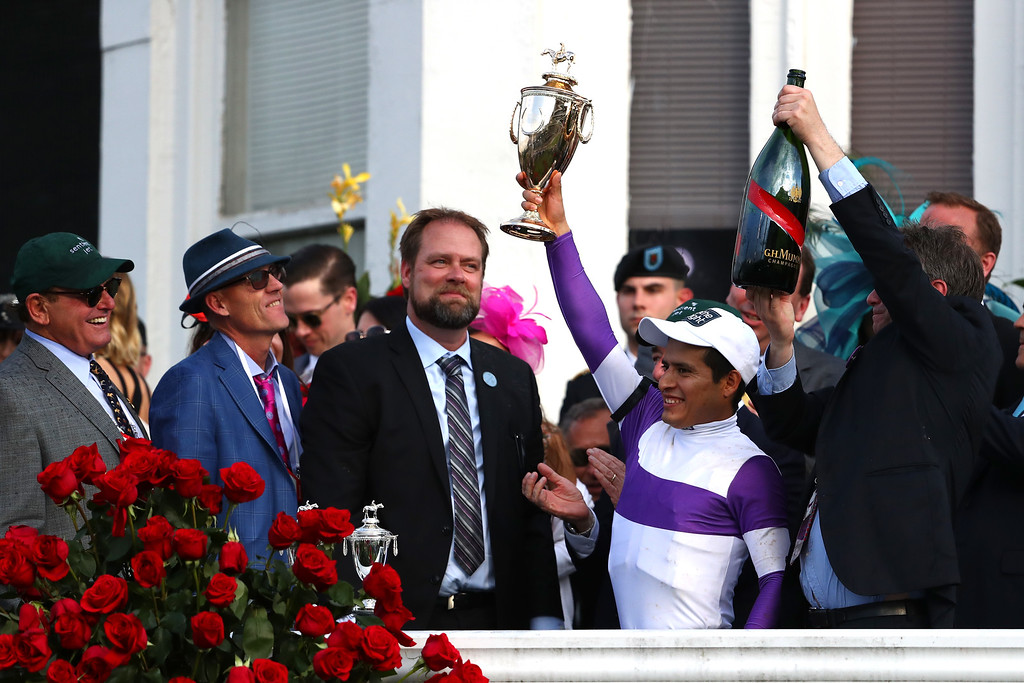 . Trainer Doug O\'Neill and Jockey Mario Gutierrez celebreate in winner circle after Nyquist #13 won the 142nd running of the Kentucky Derby at Churchill Downs on May 07, 2016 in Louisville, Kentucky.  (Photo by Maddie Meyer/Getty Images)