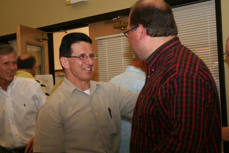 Fr. Mark Mastin congratulates Br. Duane Lemke on his election.