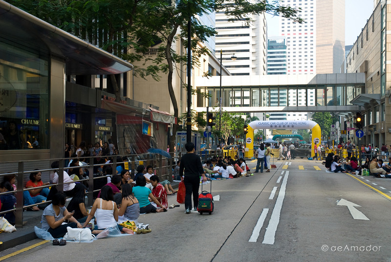 aeamador©-HK08_DSC0083  Hong Kong, downtown area, near ifc tower. I was very impressed by the affluence evidenced in this area. Hong Kong is quite a chic and fine place. These are Filipino maids that fill the entire downtown public spaces (sidewalks, streets and plazas) for picnicking. There are thousands of them, spread all over. No husbands, no men, no children. Just the women. Sunday is their day off.