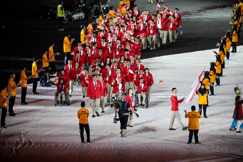 APG Opening Ceremony - Singapore's Suhairi Suhani leading the flag march of the Singapore contingent at the APG Opening Ceremony, held at Bukit Jalil Stadium on September 17th, 2017 (Photo by Sanketa Anand)