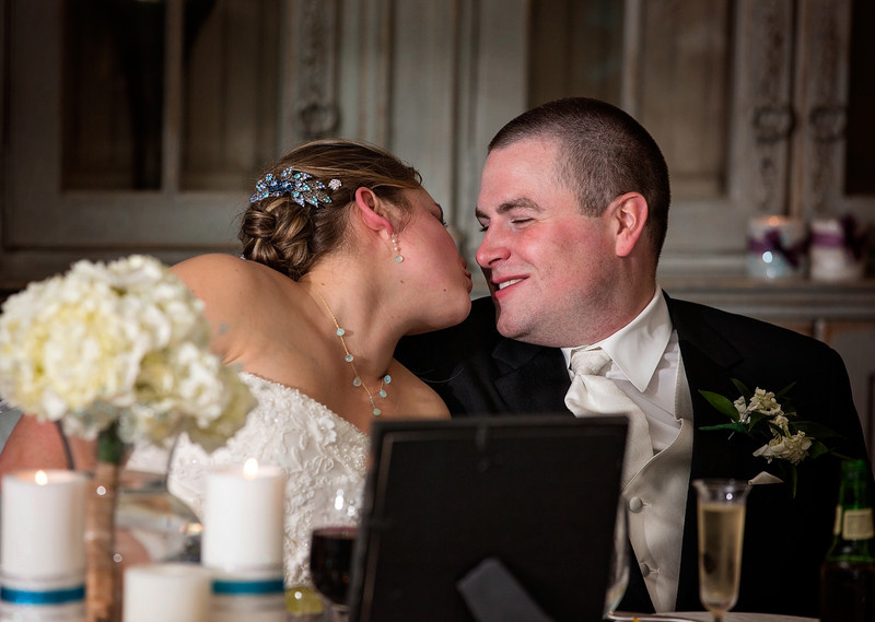 Bride and Groom about to  kiss at the head table.jpg