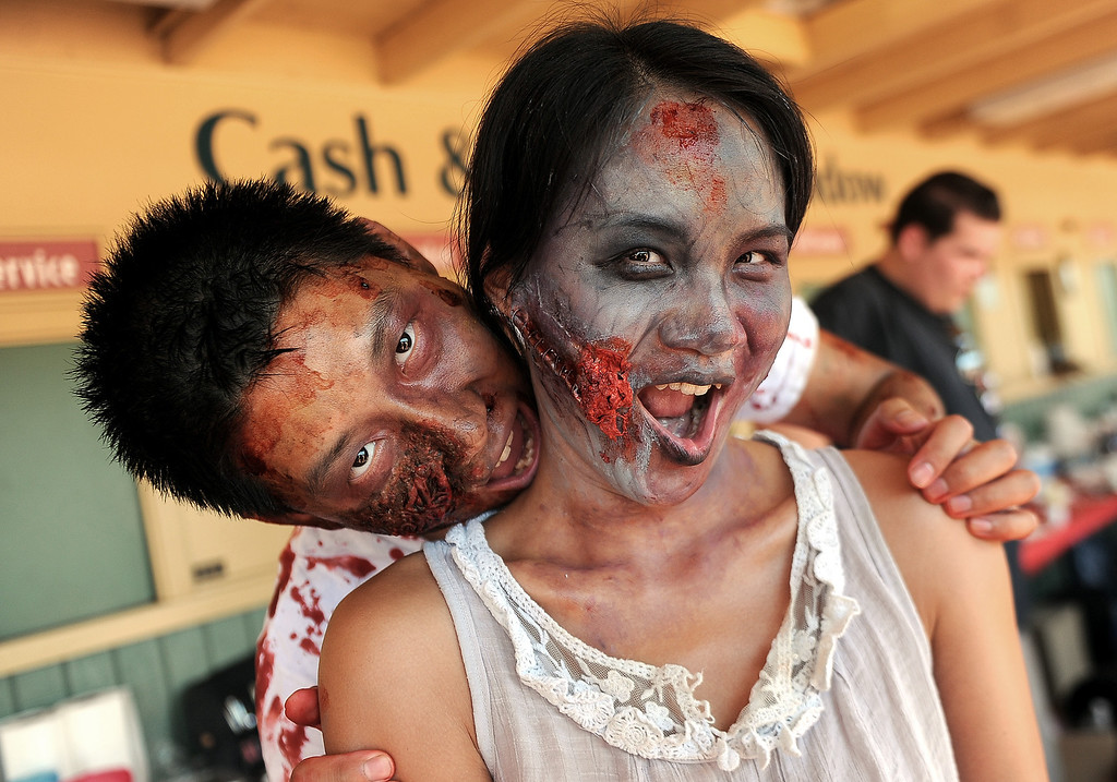 . Vincent, left, Zou with his wife Yiji Zou of Hacienda Heights after having zombie make-up applied during the Zombie Blood Run at Santa Anita Park on Saturday, Aug. 17, 2013 in Arcadia, Calif. The American Red Cross San Gabriel Pomona Valley chapter is partnering with the Zombie Blood Run to prepare the San Gabriel Valley for a disaster, even a zombie apocalypse.  (Keith Birmingham/Pasadena Star-News)