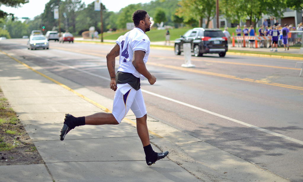 . Vikings wide receiver Joe Webb runs across Stadium Road back to the locker room at the conclusion of training camp in Mankato.  (Pioneer Press: Chris Polydoroff)