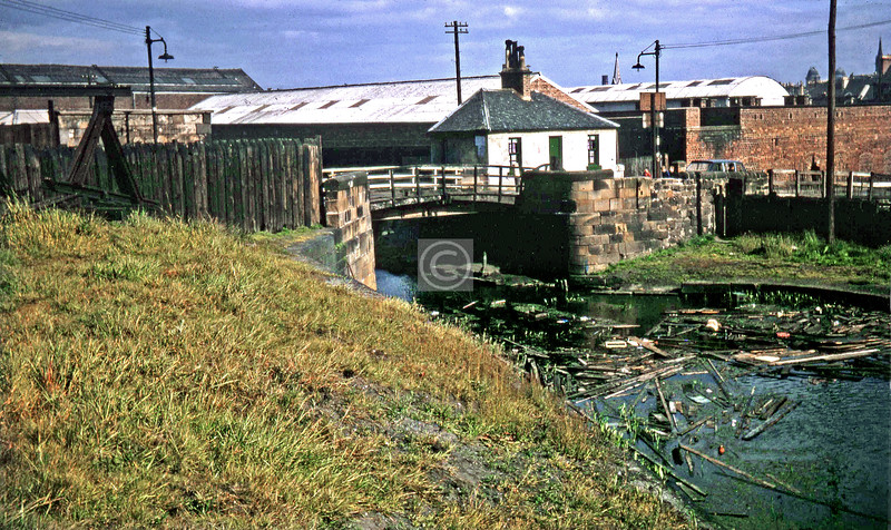 The bascule bridge which carried Glebe St over the cut to Pinkston Rd, with the bridgekeeper's cottage. The cottage was demolished in 1965 and the bridge in 1967.  