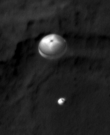 Description of . FILE - This late Sunday, Aug. 5, 2012 PDT photo made available by NASA shows the Curiosity rover, bottom, and its parachute descending to the surface from the vantage point of the Mars Reconnaissance Orbiter. (AP Photo/NASA)