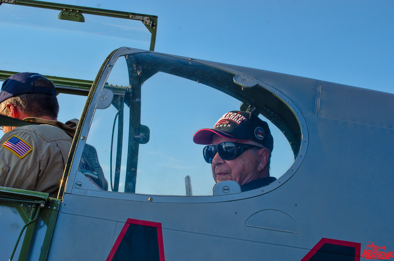 Lt. Col. George Hardy returning from his flight in the Mustang.