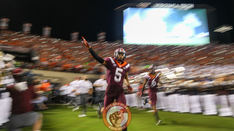 DB Bryce Watts runs onto the field during Enter Sandman minutes before kickoff. (Mark Umansky/TheKeyPlay.com)