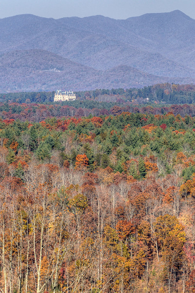The Biltmore Estate sits nestled at the base of a mountain and surrounded by beautiful fall colors, as seen from near Milepost 400 on the Blue Ridge Parkway in North Carolina on Sunday, November 3, 2013. Copyright 2013 Jason Barnette