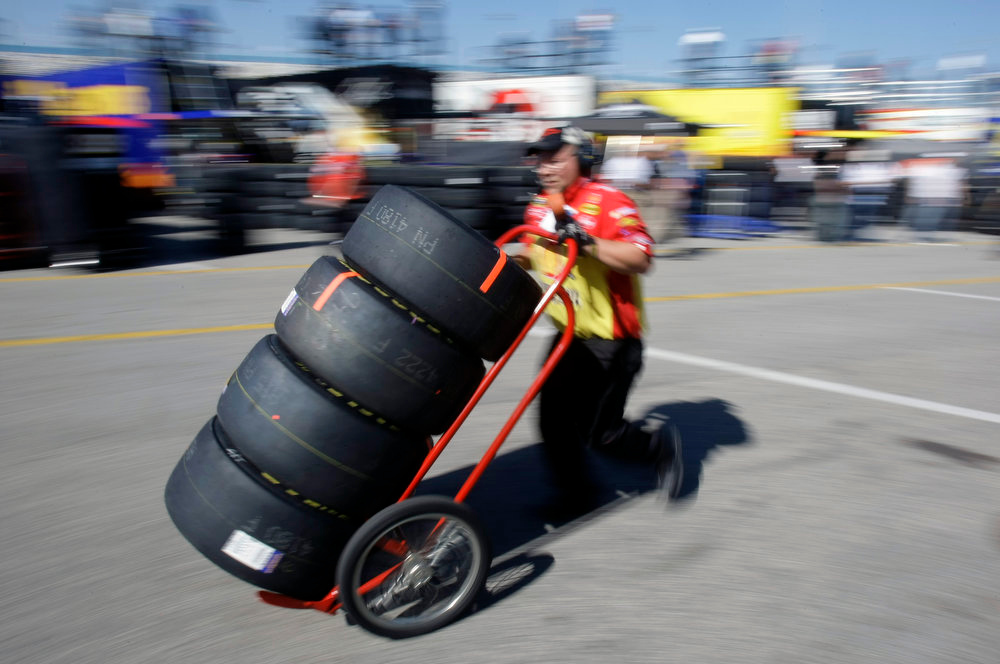 Description of . A NASACR crew member delivers a cart full of tires to a garage during practice for the Daytona 500 auto race at the Daytona International Speedway in  Daytona Beach, Fla., Friday, Feb. 13, 2009. (AP Photo/John Raoux)