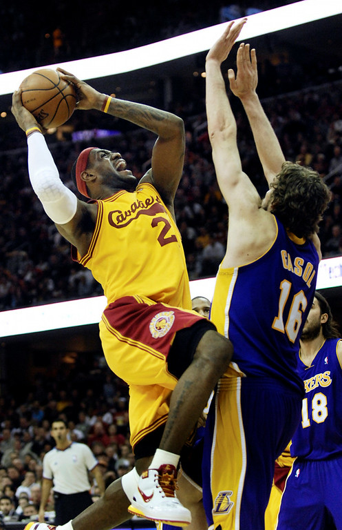 . Jeff Forman/JForman@News-Herald.com LeBron James shoots over Pau Gasol during the Cavaliers loss to the Lakers Sunday at Quicken Loans Arena.