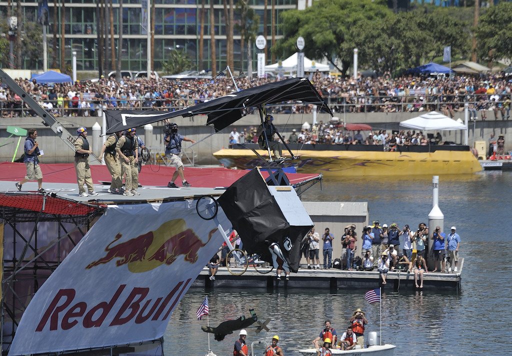 """. LONG BEACH, CALIF. USA -- Jennifer Day pilots \""""Team Stealth Ginger\"""" during the Flugtag in Rainbow Harbor in Long Beach, Calif. on August 21, 2010. Thirty five teams competed in the Red Bull event where teams build homemade, human-powered flying machines and pilot them off a 30-foot high deck in hopes of achieving flight.  Flugtag means \""""flying day\"""" in German. They are on distance, creativity and showmanship..Photo by Jeff Gritchen / Long Beach Press-Telegram.."""