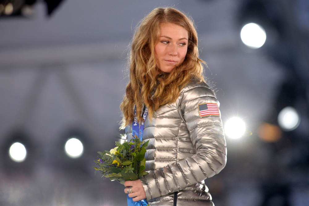 Description of . American Mikaela Shiffrin walks across the stage after receiving her gold medal during the ladies' slalom medals ceremony. Sochi 2014 Winter Olympics on Friday, February 22, 2014 at Sochi Olympic Park. (Photo by AAron Ontiveroz/ The Denver Post)