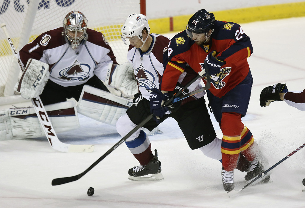 . Colorado Avalanche Nick Holden (2) blocks Florida Panthers\' Brad Boyes (24) from taking a shot as goalie Seymon Varlamov (1) watches during the first period of an NHL hockey game, Thursday, Jan.15, 2015 in Sunrise, Fla. (AP Photo/J Pat Carter)