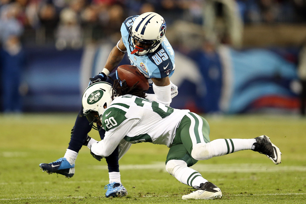 . NASHVILLE, TN - DECEMBER 17:  Wide receiver Nate Washington #85 of the Tennessee Titans gets tackled by cornerback Kyle Wilson #20 of the New York Jets at LP Field on December 17, 2012 in Nashville, Tennessee.  (Photo by Andy Lyons/Getty Images)
