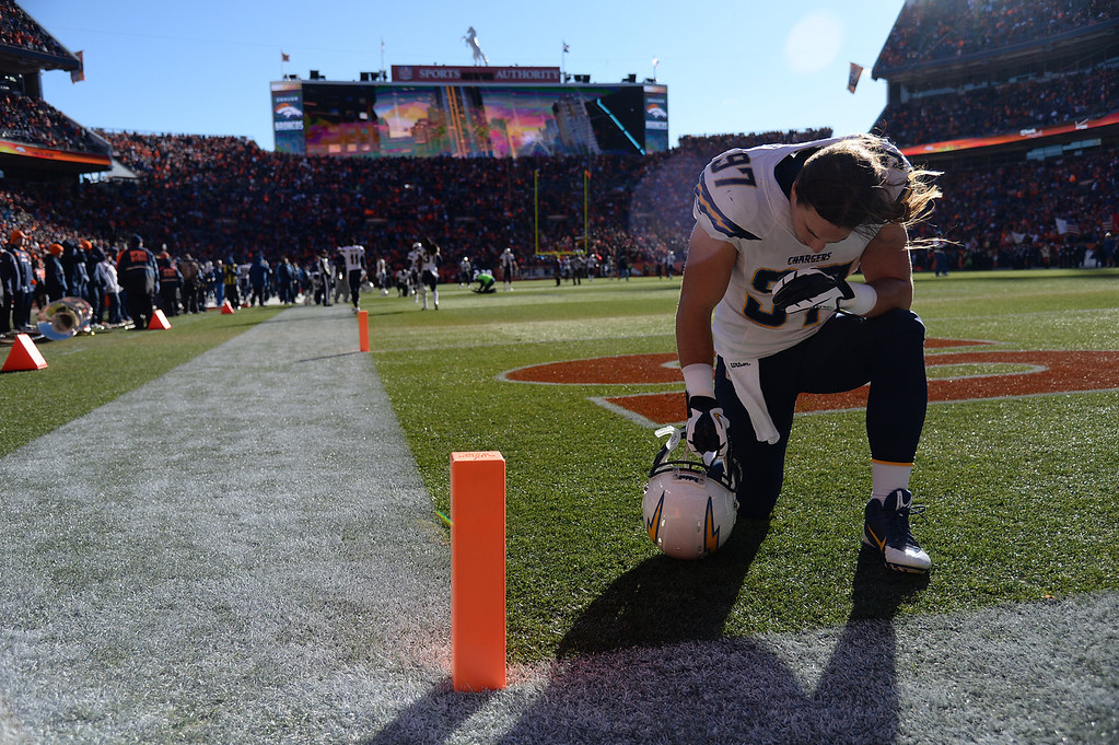 . San Diego Chargers inside linebacker Bront Bird (97) kneels before the start of the game. The Denver Broncos take on the San Diego Chargers at Sports Authority Field at Mile High in Denver on January 12, 2014. (Photo by Hyoung Chang/The Denver Post)