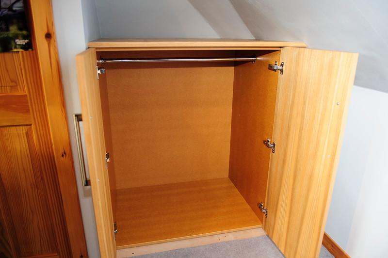 Oak veneered MDF wardrobes.