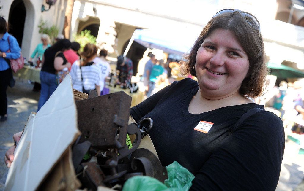 . Libby Cline smiles as she shows off her antique locks she purchased in front of the Pasadena Playhouse during the 8th Annual Pasadena ARTWalk along El Molino Avenue between Colorado Boulevard and Green Street in Pasadena, Calif., on Saturday, Oct. 12, 2013. The ArtWalk features over 30 participating artists, art sales, gallery walks, musical performances and other activities.   (Keith Birmingham Pasadena Star-News)