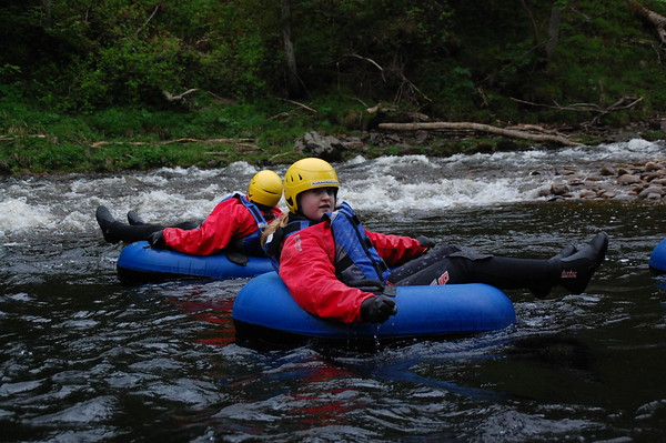 Sarah , Libby and Darren Tubing on the River Findhorn with Ace Adventure