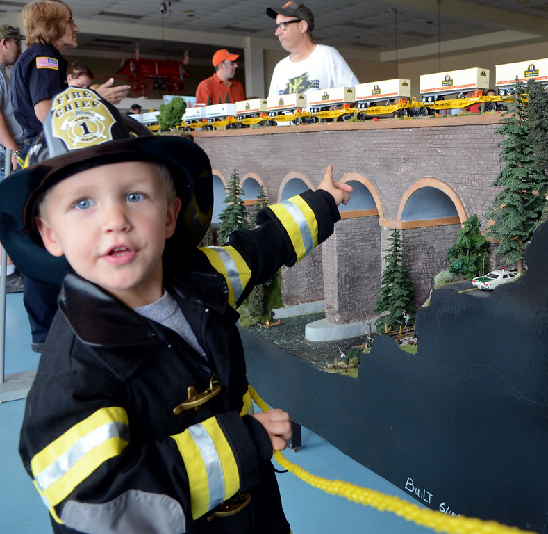 . Camryn Fickert ,3, checks out a model train display by the North Penn \'O\' Guagers at an open house of the Fairmount Fire Company during the Lansdale Founders Day  celebration on Saturday August 23,2014. Photo by Mark C Psoras/The Reporter
