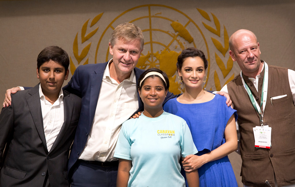 . U.N. Environment chief Erik Solheim, second left, poses for photographs with Aditya Mukarji, left, Rajeshwari Singh, center, Bollywood actor Dia Mirza and Yuri Afanasiev, right, the UN Resident Coordinator and UNDP Resident Representative in India, at a function, in New Delhi, India, Monday, June 4, 2018. The function was held to felicitate Rajeshwari Singh who has walked 1,100 kilometers (684 miles) from Vadodara to India\'s capital city to spread awareness for a plastic free future. (AP Photo/Manish Swarup)