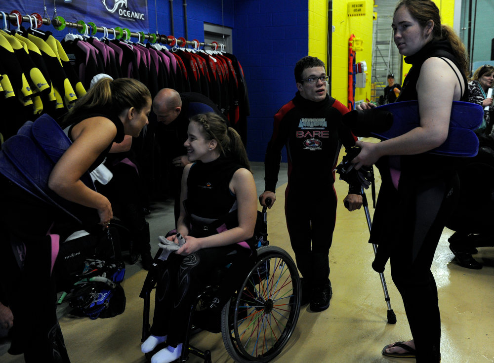 . DENVER, CO. - FEBRUARY 16: Brittney Martin, 18, (wheelchair) will dive alongside her mom Dori, left, and Jonathan Wallace, 19, second from right, will dive with  friend Alyssa Gale, right. Two teens from the Riley Children\'s Foundation are learning how to scuba dive with instructors from the A-1 Scuba and Travel Aquatics Center at the Downtown Aquarium.(Photo By Kathryn Scott Osler/The Denver Post)