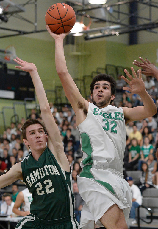 . Hamilton#22 Jordan Baldridge can\'t stop Eagle Rock#32 Stewart Ramirez. The boys from Eagle Rock defeated Hamilton 68-56 in the City Section Division III Boys basketball final. Los Angeles, CA. March 8, 2014 (Photo by John McCoy / Los Angeles Daily News)