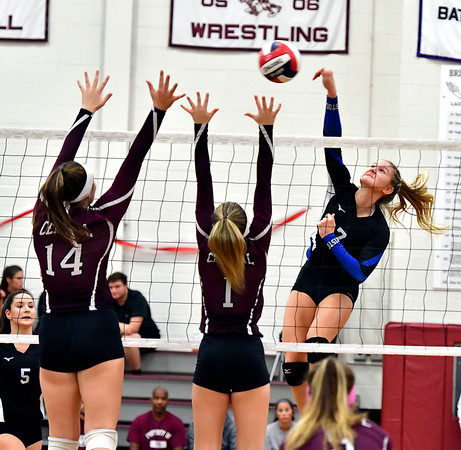 10/30/2019 Mike Orazzi | StaffrBristol Central Kathryn Ross (14) and Jadyn Bauer (1) at the net with Bristol Eastern's Zoe Lowe (7) during Wednesday night's volleyball match at Bristol Central.