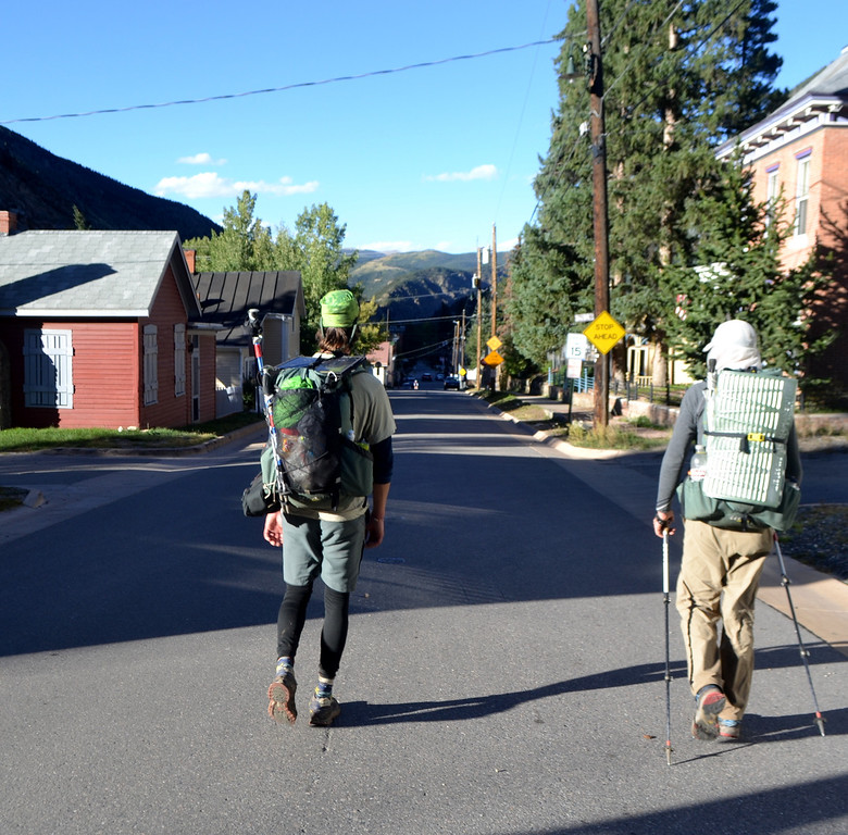 . Luke DeMuth, left and Junaid Dawud hike into Georgetown on Sept. 25, the 67th consecutive day of their mission to hike 1,300 miles and climb 57 of the state\'s 58 14,000-foot peaks and plan to finish their 70-day mission Sunday on Longs Peak.