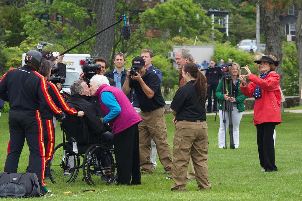 . Former first lady Barbara Bush greets her husband and former U.S. President George H.W. Bush with a kiss after his successful skydive down to St. Anne\'s Episcopal Church on June 12, 2014 in Kennebunkport, Maine. The President is celebrating his 90th birthday today.   (Photo by Eric Shea/Getty Images)