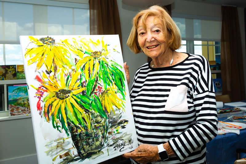 Irene Meyerson, 94,  poses with one of her paintings created in art class at Tradition at MorseLife in West Palm Beach on Wednesday, October 31, 2018. Meyerson has been a resident for one year at Tradition. [JOSEPH FORZANO/palmbeachpost.com]