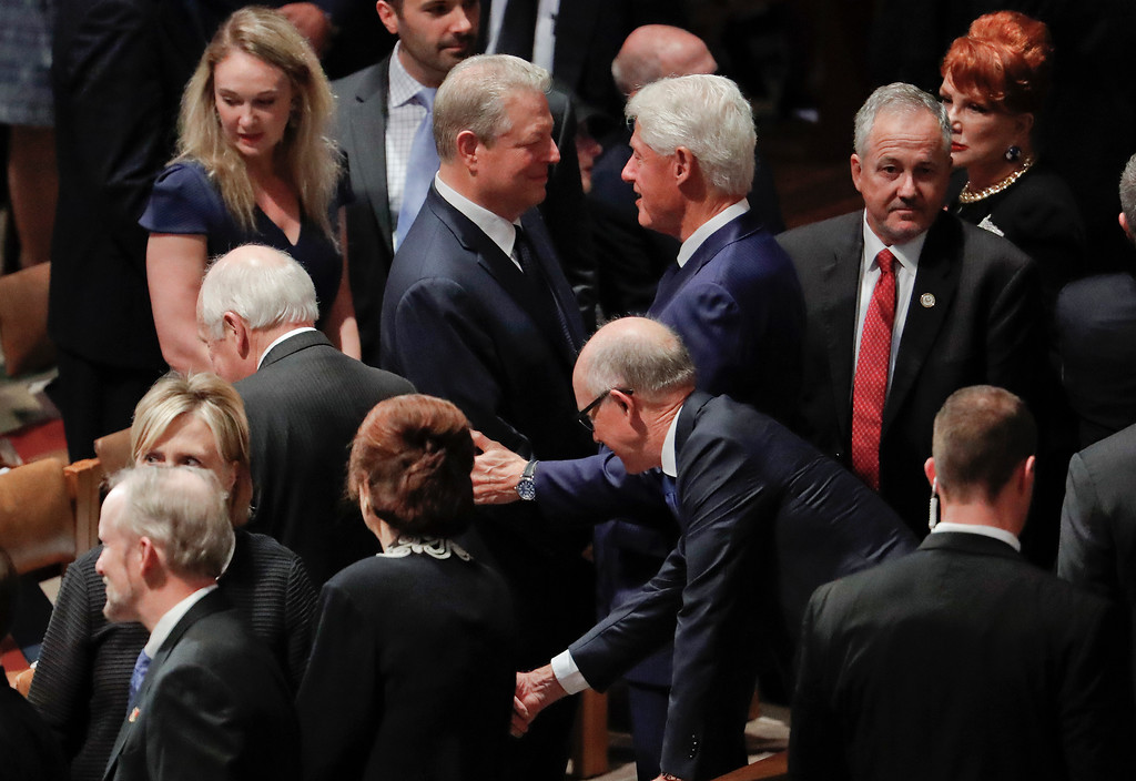 . Former President Bill Clinton, right, greets former Vice President Al Gore, left, as they arrive with other dignitaries and invited guests to attend a memorial service for Sen. John McCain, R-Ariz., at Washington National Cathedral in Washington, Saturday, Sept. 1, 2018. McCain died Aug. 25, from brain cancer at age 81. (AP Photo/Pablo Martinez Monsivais)