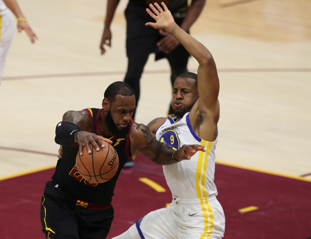 . Cleveland Cavaliers\' LeBron James goes to the basket against Golden State Warriors\' Andre Iguodala in the first half of Game 3 of basketball\'s NBA Finals, Wednesday, June 6, 2018, in Cleveland. (AP Photo/Carlos Osorio)