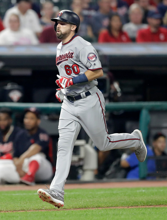 . Minnesota Twins\' Jake Cave runs the bases after hitting a solo home run in the ninth inning of a baseball game against the Cleveland Indians, Tuesday, Aug. 28, 2018, in Cleveland. (AP Photo/Tony Dejak)