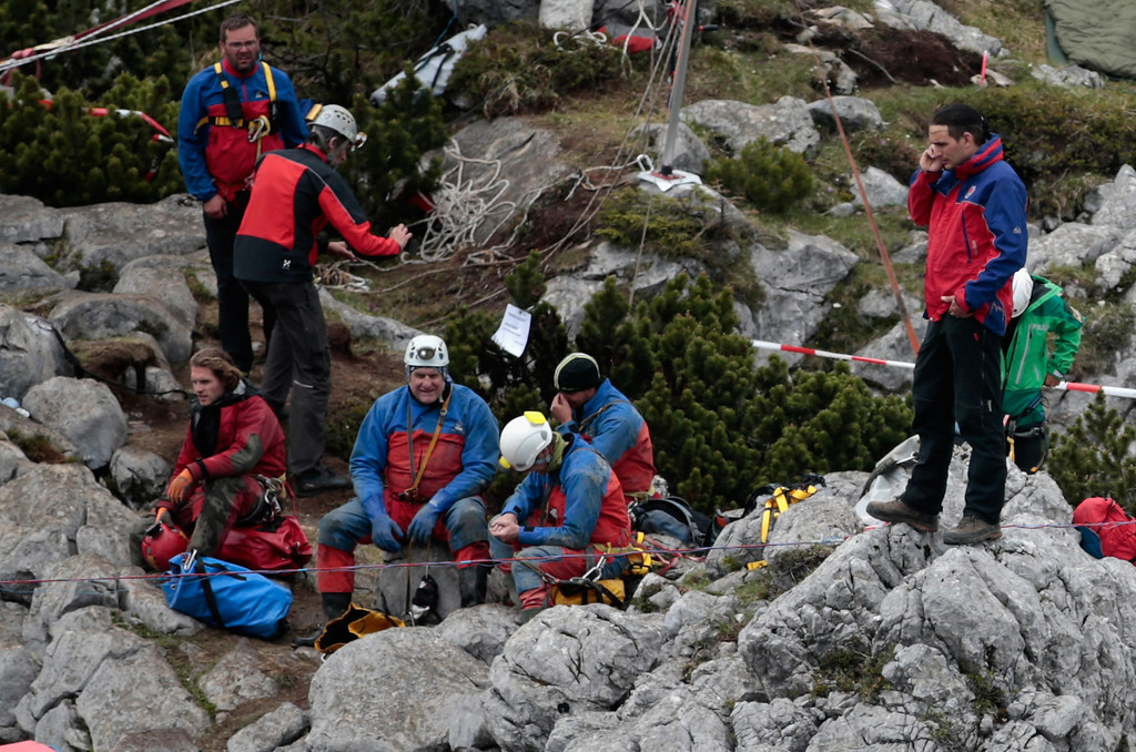 . workers stand at the entrance to the Riesending vertical cave after the final phase of the transport of injured spelunker Johann Westhauser to the surface on June 19, 2014 near Marktschellenberg, Germany.  (Photo by Johannes Simon/Getty Images)