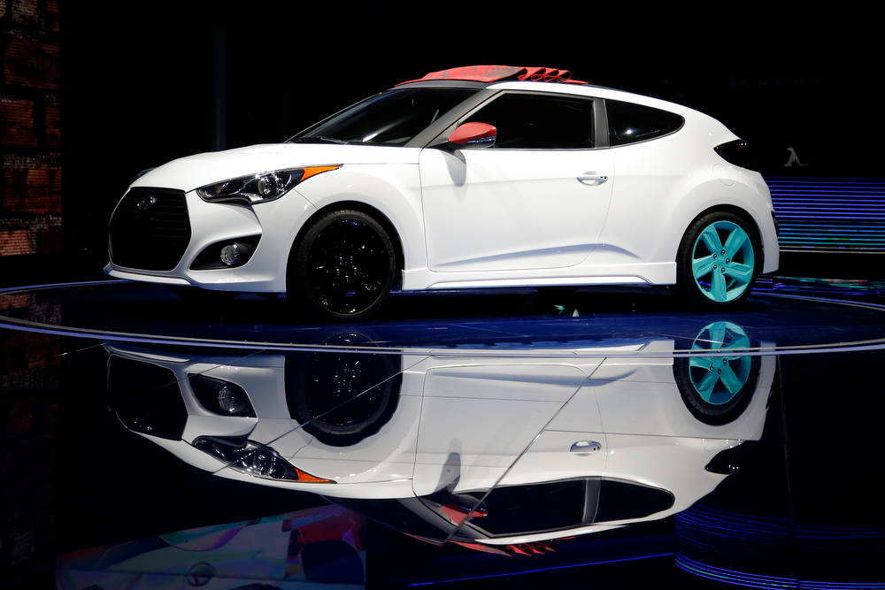 Description of . The Hyundai Veloster C3 concept is unveiled at the LA Auto Show in Los Angeles, Wednesday, Nov. 28, 2012. The annual Los Angeles Auto Show opened to the media Wednesday at the Los Angeles Convention Center. The show opens to the public on Friday, November 30. (AP Photo/Jae C. Hong)